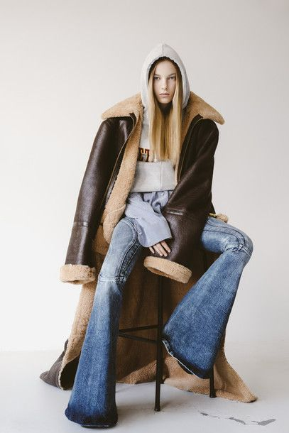 Female in long coat editorial fashion